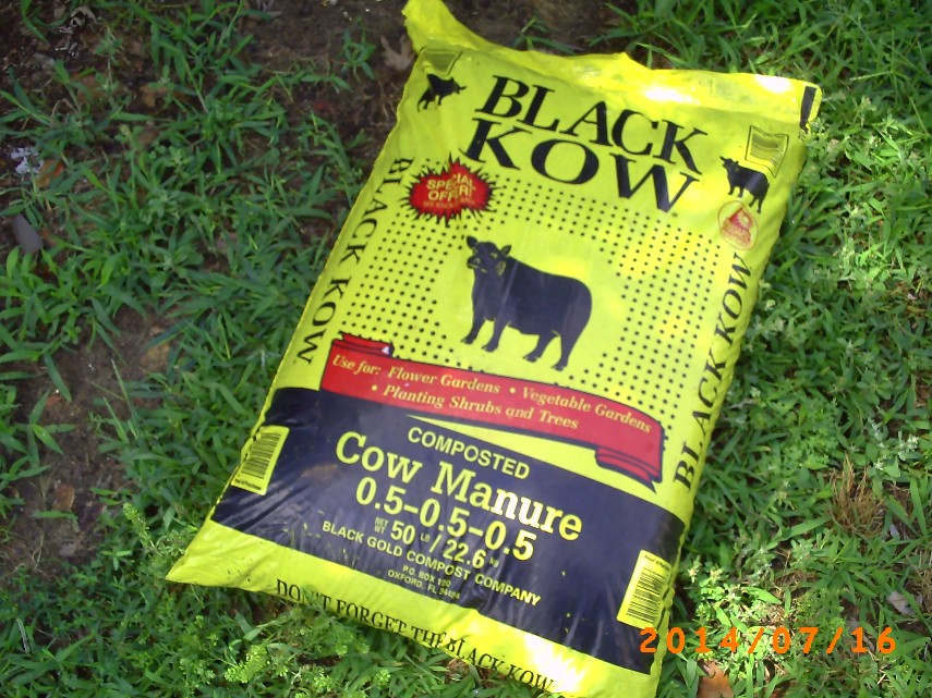 Yellow, 50 lb bag of composted cow manure